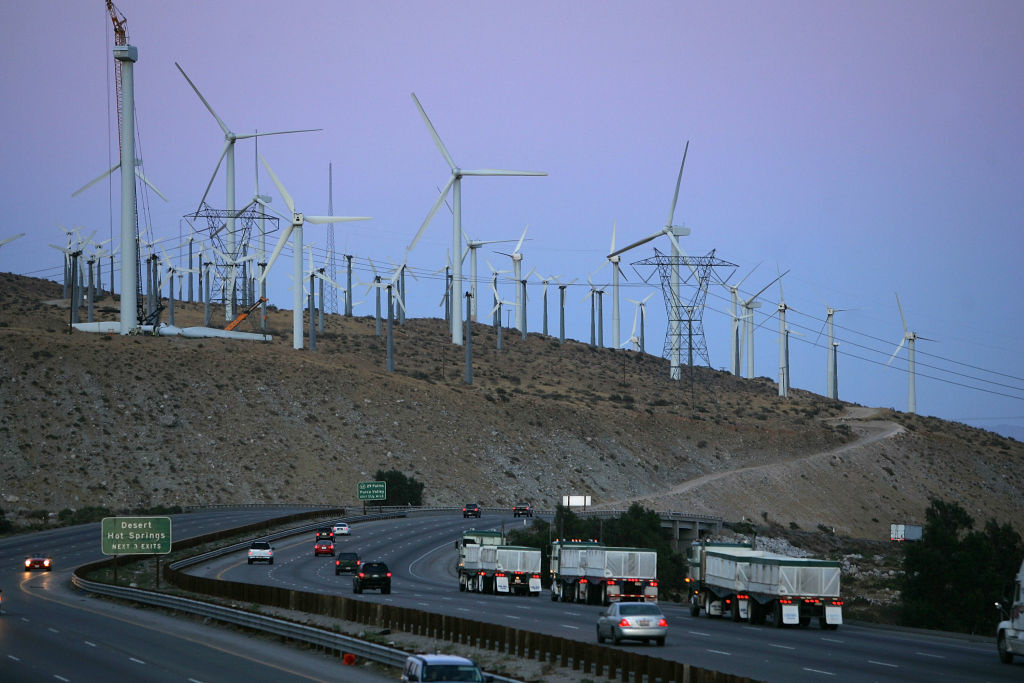 Giant wind turbines near the Interstate 10 freeway are powered by strong prevailing winds on May 13, 2008 near Palm Springs. A US government report released this week concludes that wind energy could generate 20 percent of the electricity produced in the US by 2030, as much as is currently provided by nuclear reactors. Although wind energy constitutes only about 1 percent of the electricity of the nation, wind energy is experiencing a growth spurt with an increase of 45 percent jump last year. The report envisions more than 75,000 new wind turbines, many of them bigger than those in use today, and many of them in offshore waters to increase production from the current 16,000 megawatts of power to 300,000 megawatts. The report does not predict that such growth will actually occur but rather that it is possible.