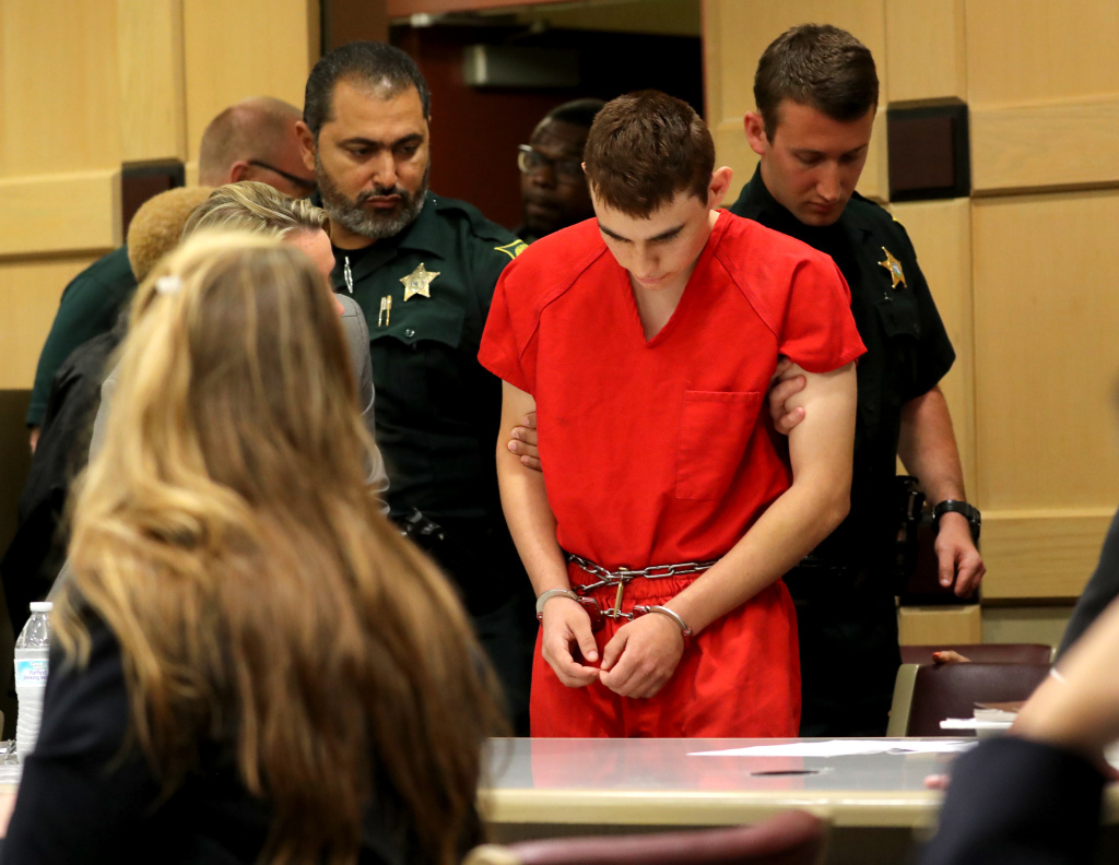 In this file photo, Nikolas Cruz appears in court for a status hearing before Broward Circuit Judge Elizabeth Scherer on February 19, 2018 in Ft. Lauderdale, Florida.