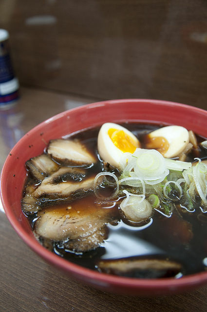 A bowl of black soy sauce ramen