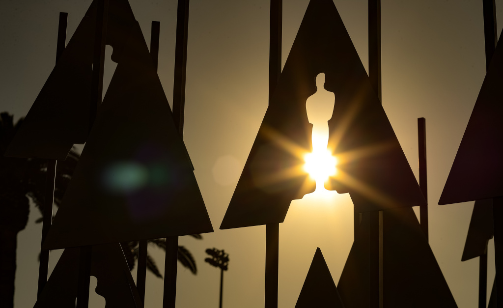 The sun shines through a silhouette of an Oscar statue at the 90th Annual Academy Awards