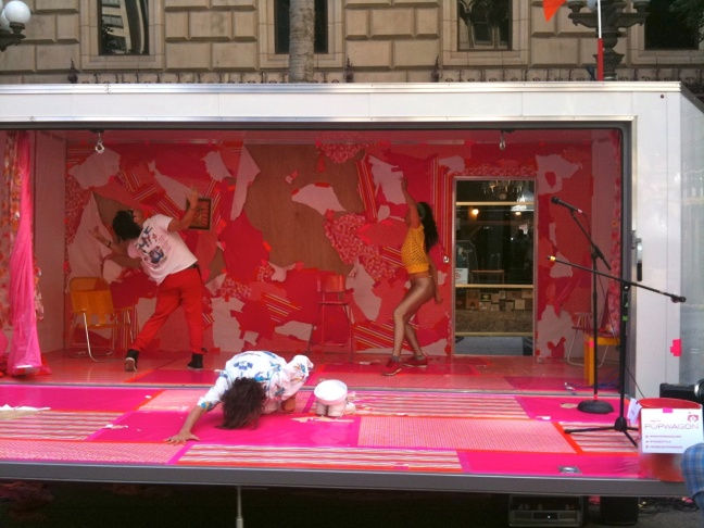 Dancers mid-pose in the movable performance space, Pop Wagon.