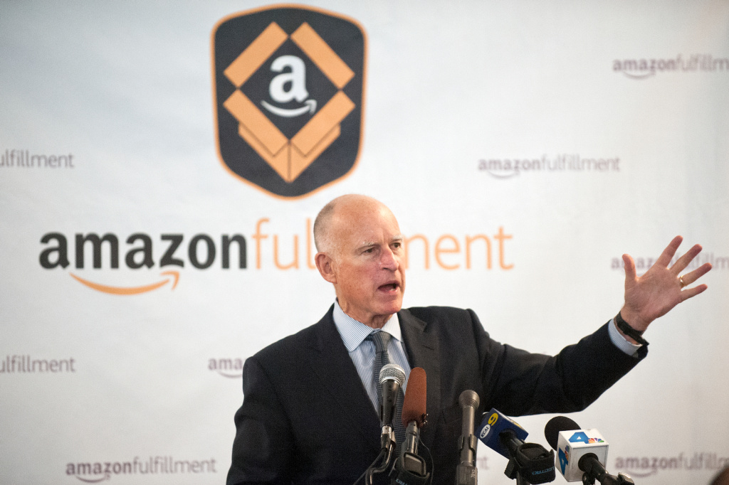 In this file photo from Oct. 29, 2013, Governor Jerry Brown speaks during a media event for the grand opening of Amazon's fulfillment center in San Bernadino. Brown and state legislators will be getting raises of a little more than 5 percent starting Sunday.