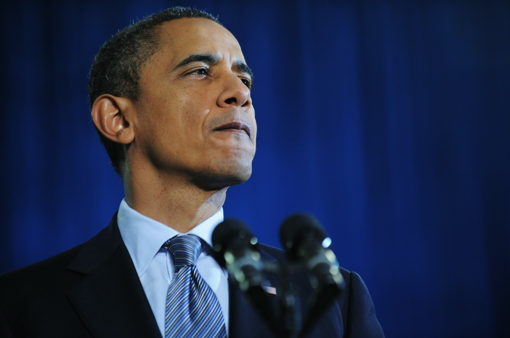 US President Barack Obama pauses as he speaks on the economy and an extension of the payroll tax cut at Osawatomie High School December 6, 2011 in Osawatomie, Kansas.