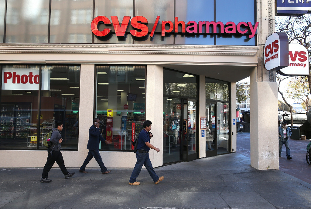SAN FRANCISCO, CA - NOVEMBER 05:  Pedestrians walk by a CVS store on November 5, 2013 in San Francisco, California.  CVS Caremark reported a 25 percent surge in third-quarter earnings with profits of $1.25 billion, or $1.02 per share, compared to $1.01 billion, or 79 cents a share one year ago. (Photo by Justin Sullivan/Getty Images)