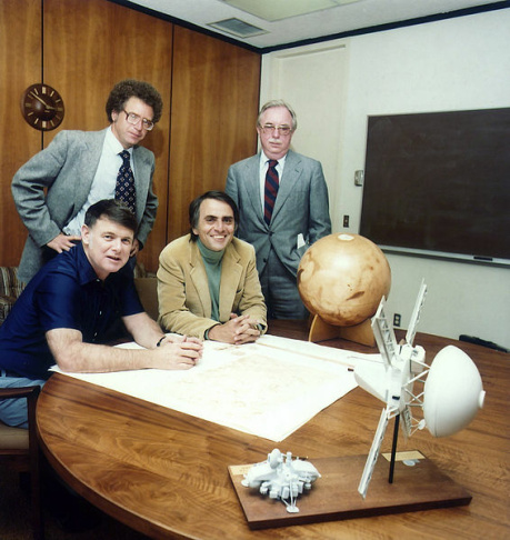 From left to right: Bruce Murray, Carl Sagan (seated) with Louis Friedman and Harry Ashmore (standing).