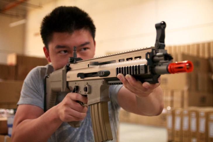 Caleb Wu demonstrates an automatic airsoft gun.