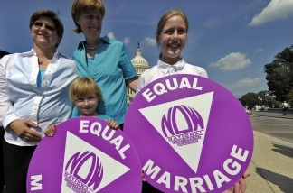 Jen and Dawn Barbouroske pose with their daughters McKinley and Bre on Sept. 15, 2009, following a news conference with married same-sex couples on legislation to repeal the Defense of Marriage Act outside the Capitol Hill in Washington, DC. The Obama Administration announced on Feb. 23, 2011, that it will no longer defend the federal ban on same-sex marriage.