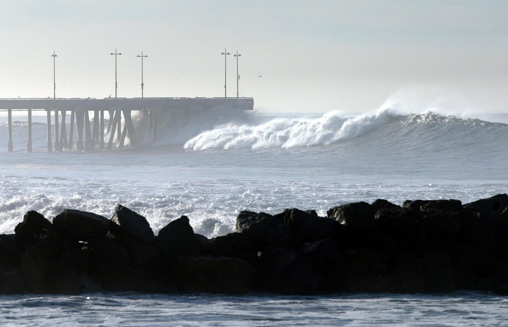 Large waves break at the Venice Beach Pier.
