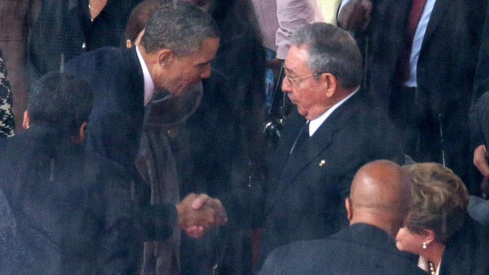 President Barack Obama shakes hands with Cuban President Raul Castro ...