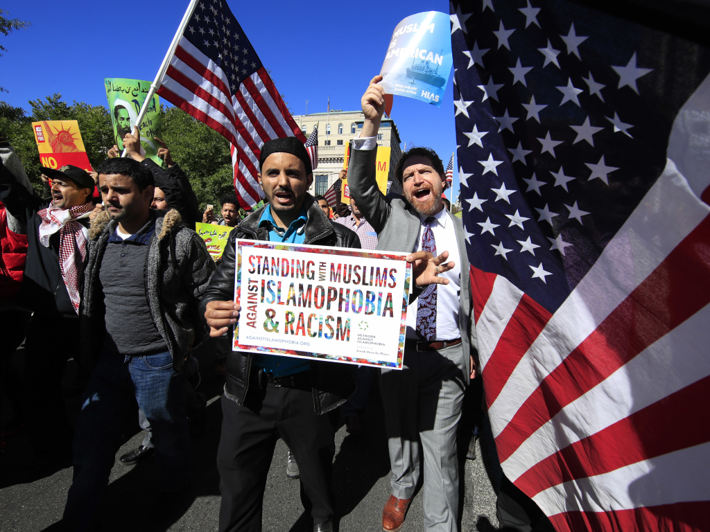 Muslim and civil rights groups and their supporters gather at a rally against what they call a