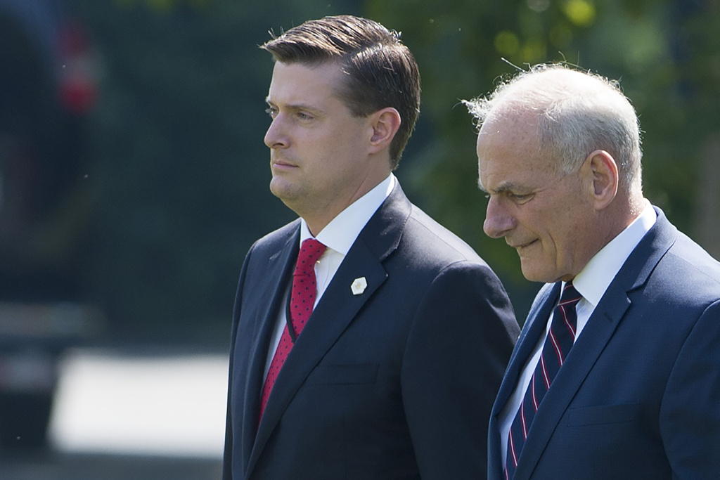 White House Staff Secretary Rob Porter (left) and Chief of Staff John Kelly (right) walk to Marine One at the White House on August 4, 2017.