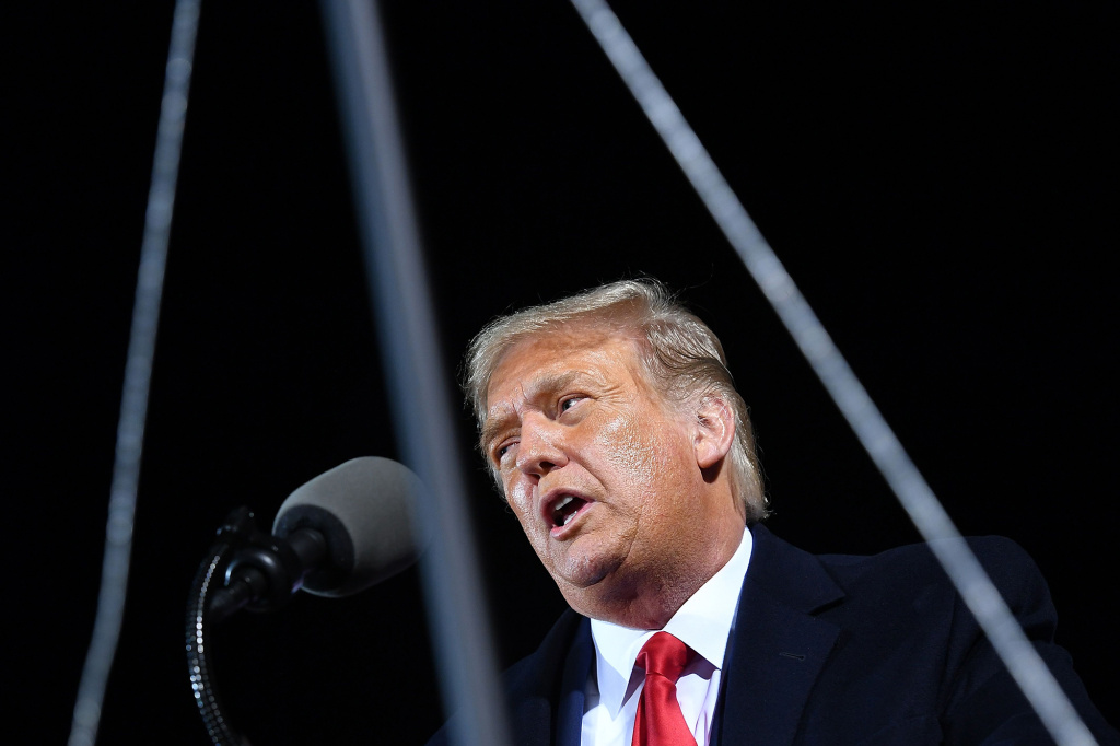 President Donald Trump speaks at a campaign rally at Duluth International Airport in Duluth, Minn., on Sept. 30. As of Friday afternoon, the president, who tested positive for the coronavirus this week,