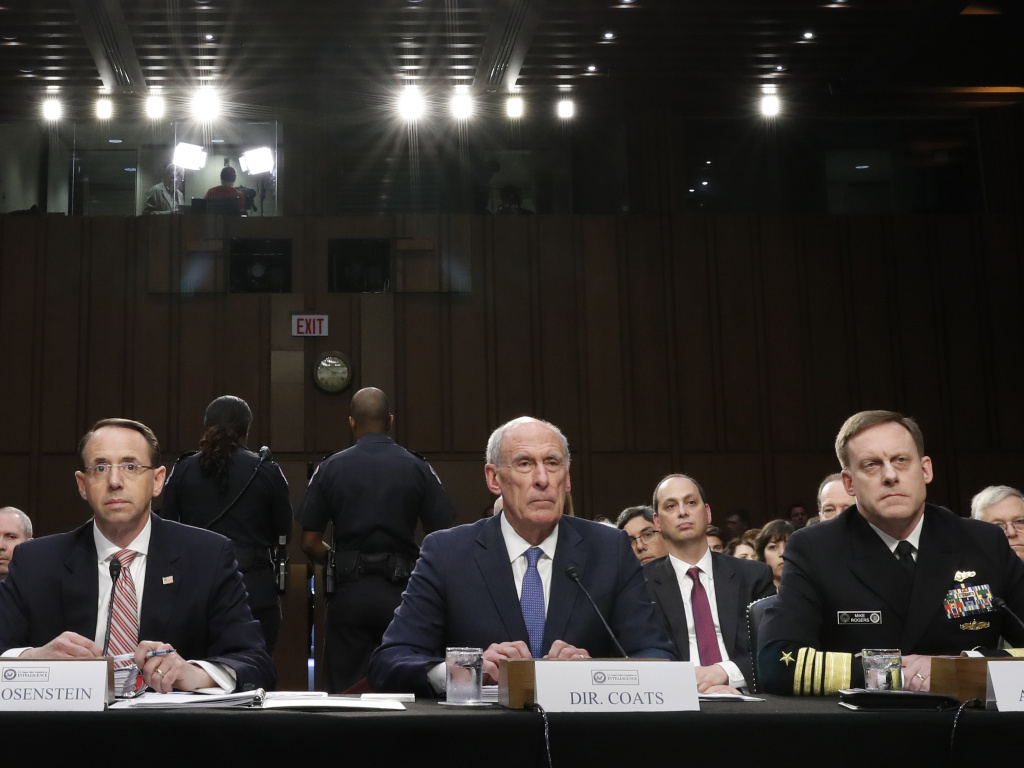 Acting FBI Director Andrew McCabe (left), Deputy Attorney General Rod Rosenstein, National Intelligence Director Dan Coats, and National Security Agency Director Adm. Michael Rogers are seated during a Senate Intelligence Committee hearing about the Foreign Intelligence Surveillance Act on Wednesday.