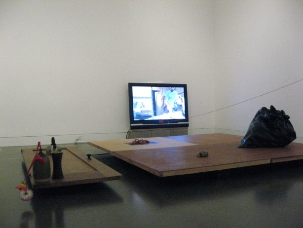 Thought Composition with Model of the World, 2010; Mixed media installation with video projection, wireless speakers, monitor, and sculpture.