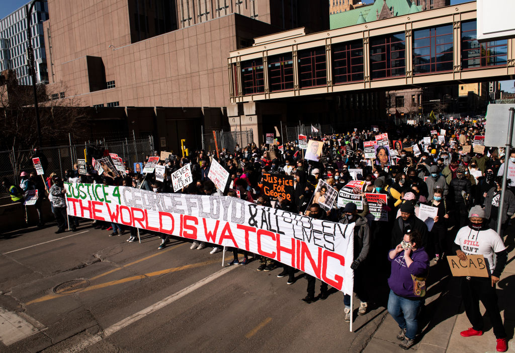 People march during a demonstration in honor of George Floyd on March 8, 2021 in Minneapolis, Minnesota. Jury selection is scheduled to begin today in the trial of former Minneapolis Police officer Derek Chauvin in the death of George Floyd last May.