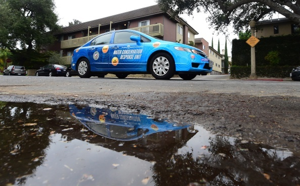 A 'water policeman' with the Water Conservation Response Unit in Los Angeles, patrols a neighborhood in Studio City, California on August 19, 2014 looking for homes or businesses wasting water during California's drought.
