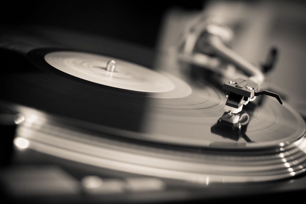 A turntable plays an LP record.