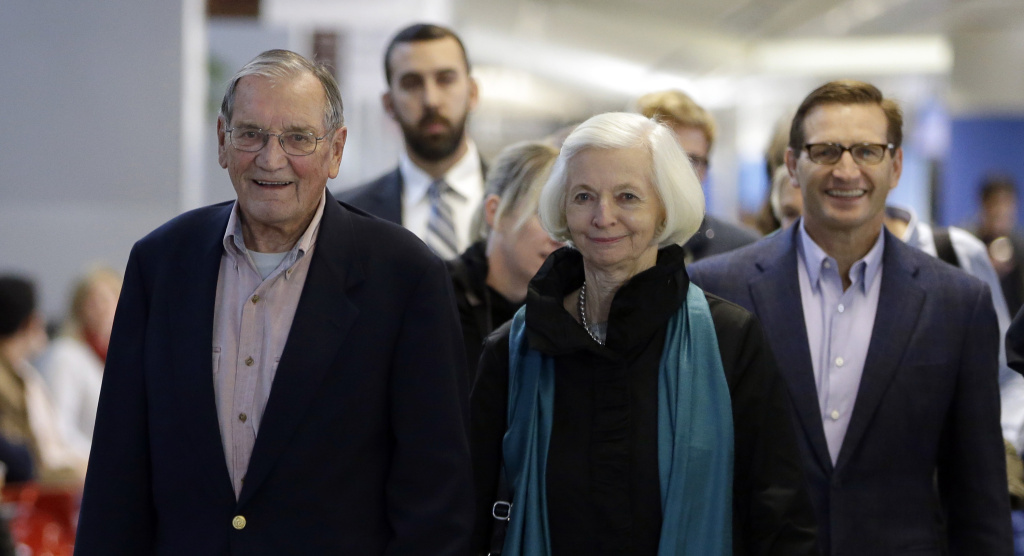 Merrill Newman (left) walks beside his wife Lee and son Jeffrey after arriving at San Francisco International Airport on Saturday.