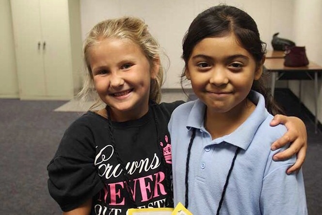 Second graders Samantha Hass and Ashley Perez after a general music class August 24, 2016.