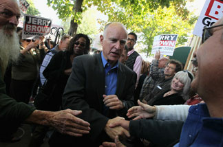 California attorney general and democratic gubernatorial candidate Jerry Brown greets supporters during a campaign rally at Broadway Heights restaurant October 31, 2010 in Chico, California.