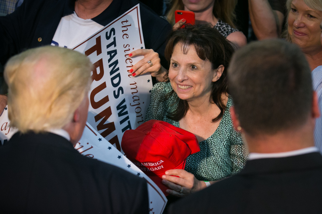 A supporter smiles upon meeting Republican Presidential candidate Donald Trump following a campaign rally on June 2, 2016 in San Jose, California. Supporters in Southern California are hoping to build on the momentum from Trump's electoral win in November.