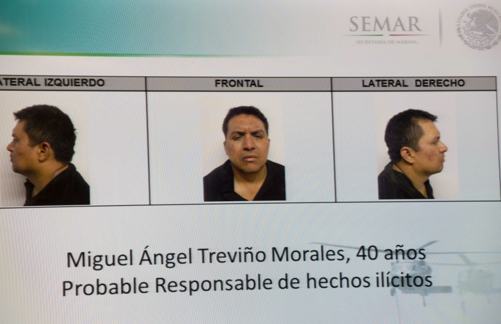 Picture taken from a sreen of the alleged maximun leader of drugs Mexican cartel 'Los Zetas', Miguel Angel Trevino Morales, presented in combo pictures during a press conference at the head quarter of Interior Ministry on July 15, 2013 in Mexico City. According to a spokesman Trevino was arrested early morning during a military operation en Nuevo Laredo.