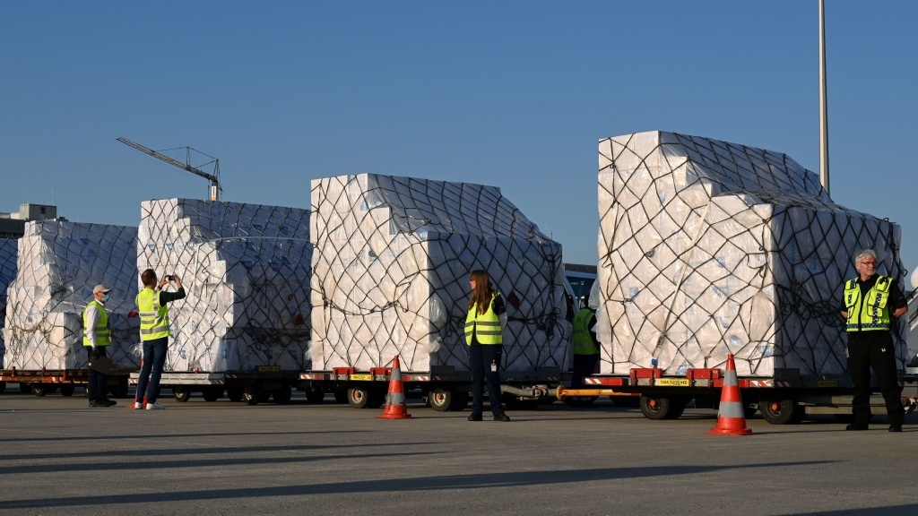 Batches of 8 million protective masks are unloaded from a Lufthansa airplane at the Franz-Josef-Strauss airport in Munich on Tuesday after arriving from Shanghai.