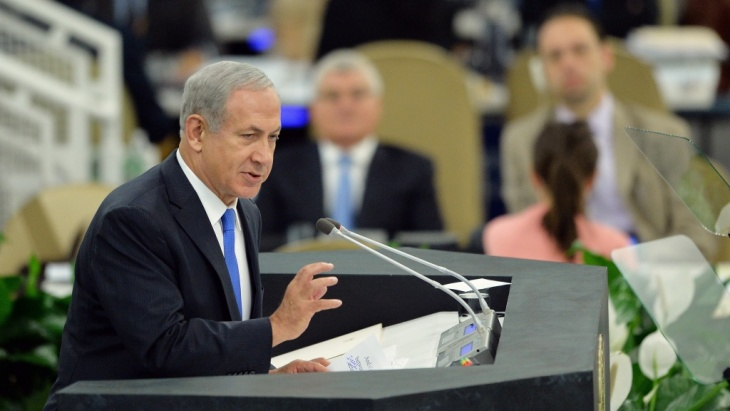 Israel's Prime Minister Benjamin Netanyahu told officials at the U.N. General Assembly Tuesday that it's too early to ease sanctions on Iran, urging them not to be fooled by what he called a charm offensive by President Hasan Rouhani.