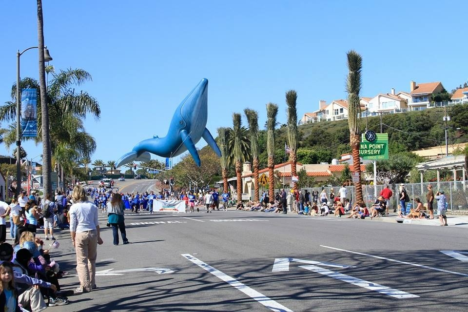 Guests watch parade to kick off the Dana Point Festival of Whales.