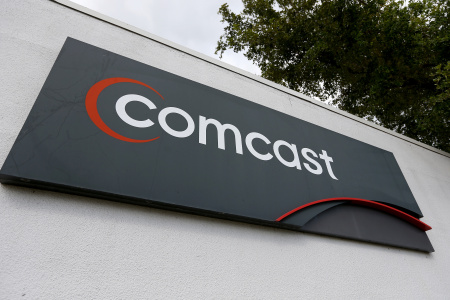 File: A Comcast sign is seen at one of their centers on Feb. 13, 2014 in Pompano Beach, Florida.