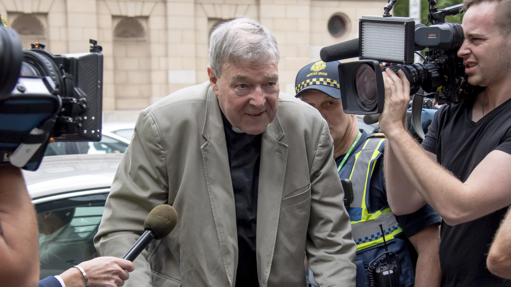 Cardinal George Pell at the County Court of Victoria in Melbourne, Australia, on Tuesday. He was convicted of child sex abuse, but journalists who reported on the case could face jail time for disobeying a gag order.