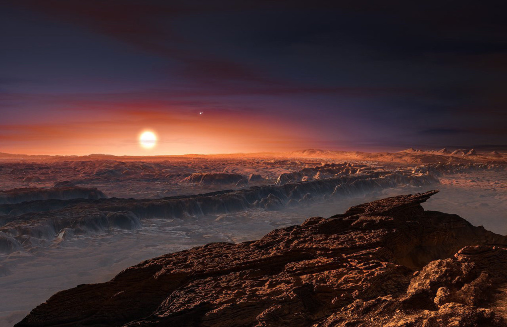 This artist's impression shows a best guess of what the surface of the planet Proxima b might look like, as it orbits the red dwarf star Proxima Centauri, the closest star to our solar system. Maybe Mars was the model?