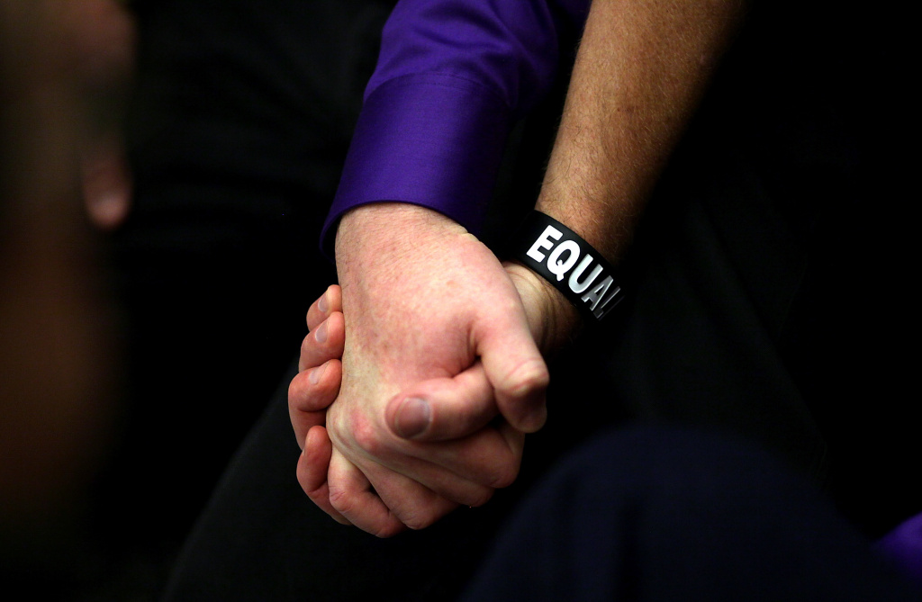 A same-sex couple hold hands during a sit-in protest when same-sex couples were denied marriage licenses on February 14, 2011 in San Francisco, California.