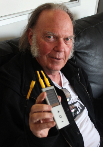 Neil Young and his Pono, a high-resolution audio player that sells for $399.
