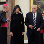 The prefect of the papal household Georg Gaenswein (L) gestures as Pope Francis (R) stands with US President Donald Trump and US First Lady Melania Trump during a private audience at the Vatican on May 24, 2017. US President Donald Trump met Pope Francis at the Vatican today in a keenly-anticipated first face-to-face encounter between two world leaders who have clashed repeatedly on several issues. / AFP PHOTO / POOL / Evan Vucci        (Photo credit should read EVAN VUCCI/AFP/Getty Images)