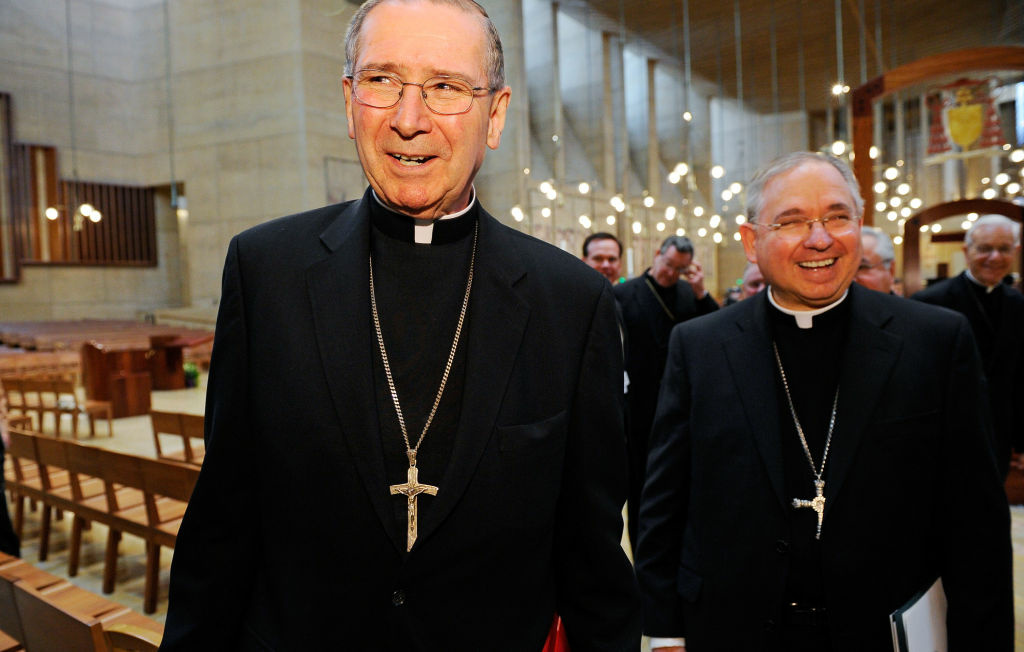 Cardinal Roger Mahony (L) walks with his successor, San Antonio, Texas Archbishop Jose Gomez (2nd L), after a news conference at the Cathedral of Our Lady of the Angels on April 6, 2010 in Los Angeles, California. Gomez, 58, will take over the archdiocese of Los Angeles when Cardinal Mahoney retires.