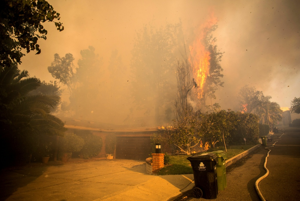A house is threatened by wildfire along Linda Flora Drive during the Skirball Fire in Los Angeles, California, December 6, 2017.