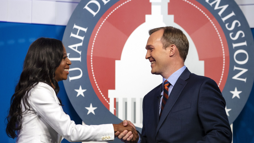 Utah Republican Rep. Mia Love and her Democratic challenger, Salt Lake County Mayor Ben McAdams, shake hands during a debate on Monday, Oct. 15, 2018, in Sandy, Utah