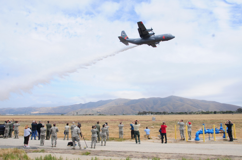 File: The California Air National Guard's C-130J drops water near onlookers during MAFFS annual certification and training at the 146th Airlift Wing in Port Hueneme, California on May 4, 2016.