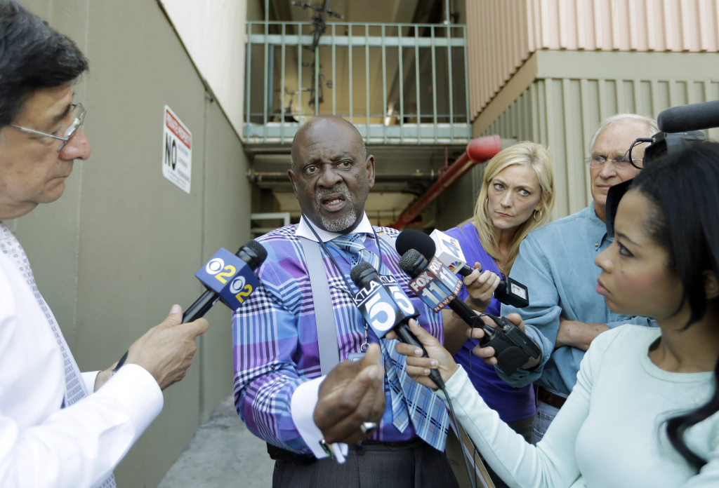 Rev. Eddie Royal Sr., who said he was the case manager for Nna Alpha Onuoha, 29, a TSA screener who has been charged with making threats to Los Angeles International Airport, talks with reporters after authorities searched an apartment said to belong to Onuoha at a veterans residence facility run by the Department of Veterans Affairs, in Inglewood, Calif., Wednesday, Sept. 11, 2013.  Onuoha was charged in federal court Wednesday with one count each of making a false threat and making threats affecting interstate commerce.
