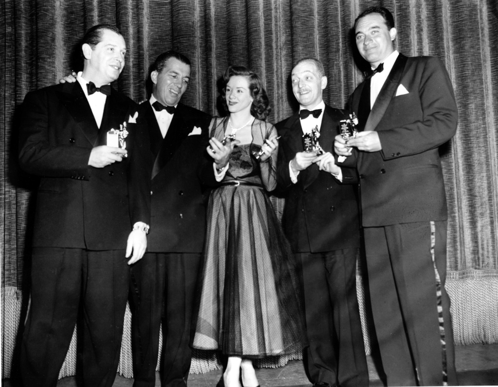 "In this March 21, 1950 file photo, actor-comedian Milton Berle, left, master of ceremonies Ed Sullivan, singer Fran Warren, Everett Sloane and Mel Allen pose with their Michael awards at the First Annual Awards and Dinner of the Academy of Television Arts and Sciences for Television and Radio in New York City. Warren, whose 1947 recording of ""A Sunday Kind of Love"" was one of the classic hits of the big band era, died of natural causes on March 4, 2013. She was 87."