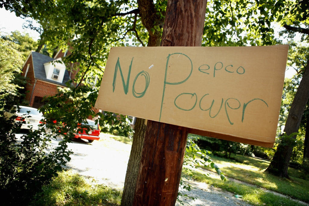 SILVER SPRING, MD - JULY 02:  A hand-written sign about local power company Pepco hangs on a pole in a residential neighborhood July 2, 2012 in Silver Spring, Maryland.  About 445,000 businesses and households in the metropolitan area surrounding the nation's capital remain without electricity three days after a deadly storm ripped a path from Illinois to the Mid Atlantic region. Almost 40-percent of Pepco customers in Montgomery County, just north of the District of Columbia, are still without electricity and the power company does not expect to have full service restored until Friday.  (Photo by Chip Somodevilla/Getty Images)