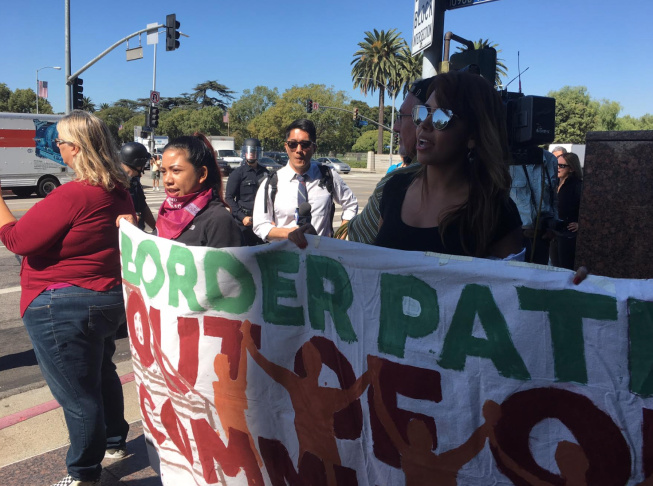 Several dozen protesters blocked an intersection in front of the federal building in West Los Angeles on Thursday, Oct. 5, 2017. Thursday was the last day for many young immigrants protected under the federal Deferred Action for Childhood Arrivals, or DACA, to renew their protection one last time before the program ends in March. The Trump administration rescinded the program last month. Many protesters were critical of lawmakers negotiating the future of DACA recipients, fearing other immigrants might be targeted in exchange.