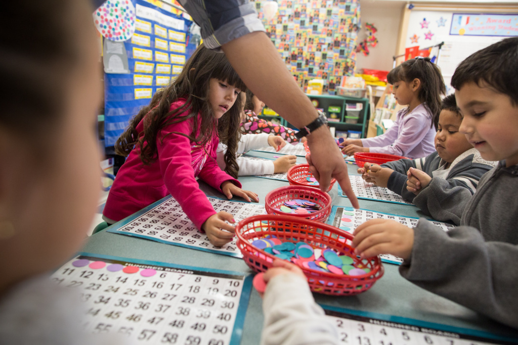 Students in a transitional kindergarten classroom at the Martha Escutia Primary Center play the hundred board game. Instead of entering kindergarten at a younger age, these kids get an extra year to learn new skills and prepare for kindergarten.