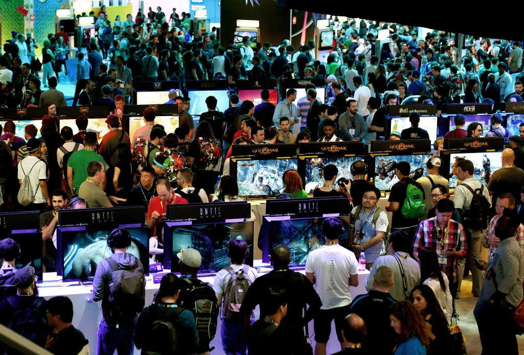 Gamers test new video games on display at the Sony Playstation area on the opening day of the Electronic Entertainment Expo, known as E3 at the Convention Center in Los Angeles, California on June 16, 2015.