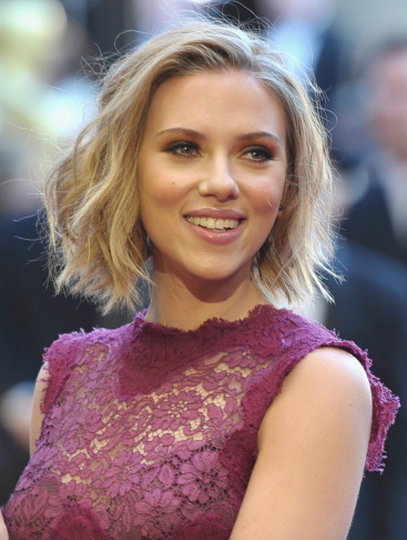 Actress Scarlett Johansson arrives at the 83rd Annual Academy Awards on February 27, 2011. A man faces 60 years in prison for hacking into her account and the accounts of other celebrities.