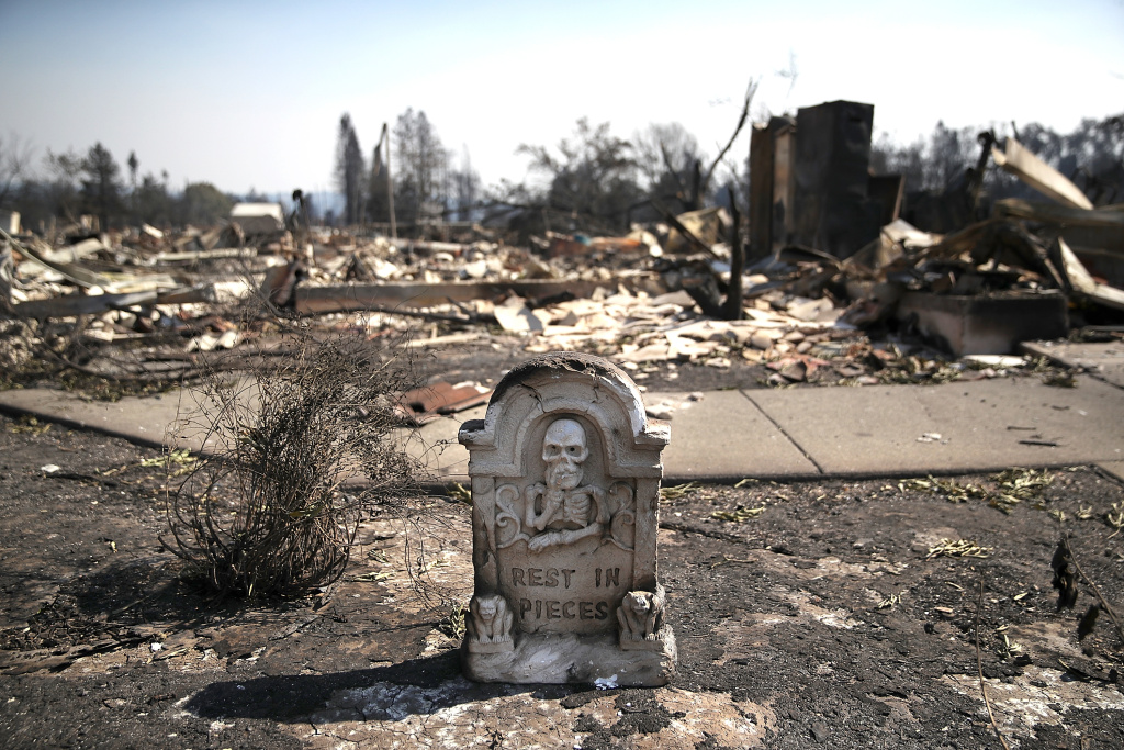 A Halloween decoration is the only thing left standing in front of homes that were destroyed by the Tubbs Fire on October 12, 2017 in Santa Rosa, California.