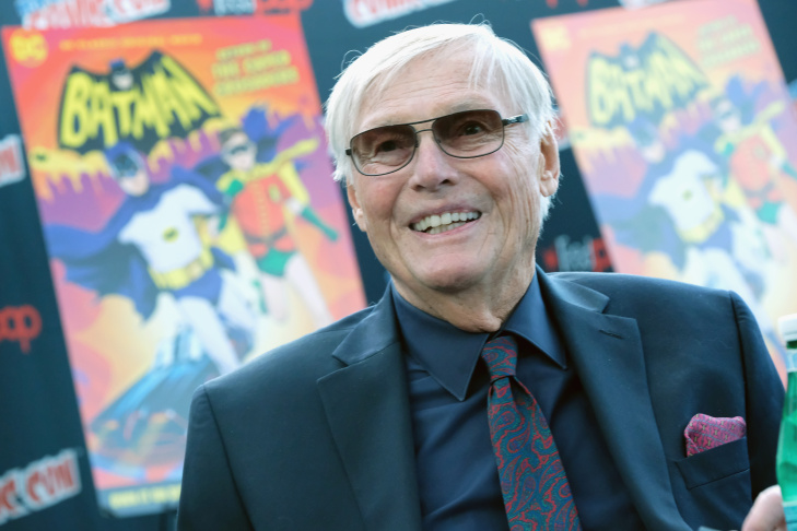 Adam West, who played Batman in the original TV series, poses while kneeling on his just unveiled star on Hollywood's Walk of Fame on April 5, 2012 in Hollywood, California.