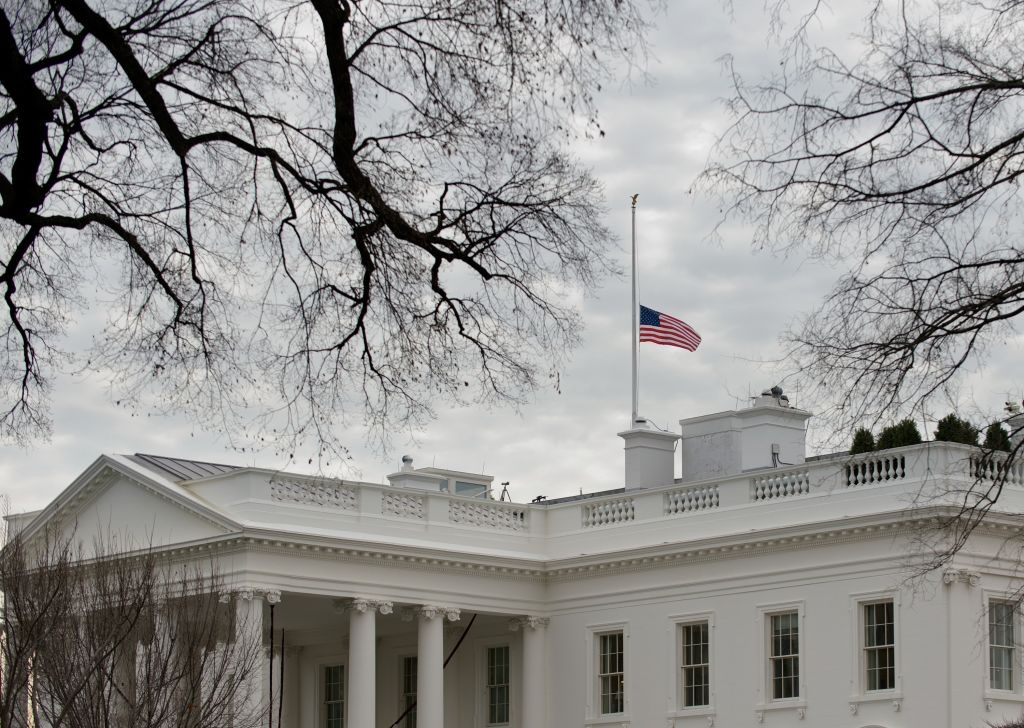 The US flag flies at half-staff above the White House on December 15, 2012 in Washington. Twenty-seven people, including the shooter, were killed on December 14 at Sandy Hook Elementary School in Newtown, Connecticut.