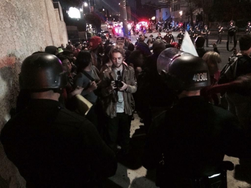 Protestors ask police to let them go.